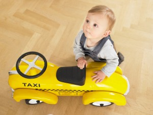 Baby with Toy Taxi